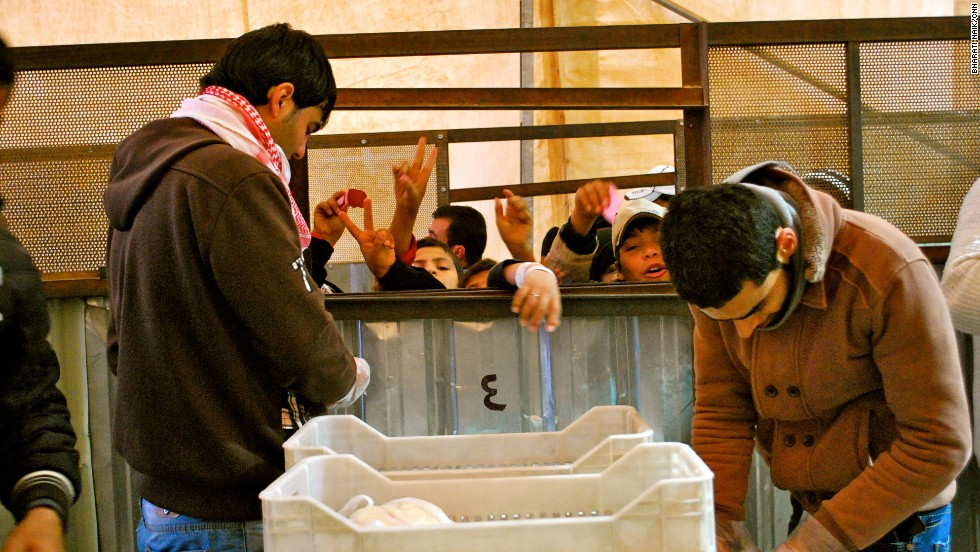 This is the World Food Program's bread distribution center in Zaatari. There are two lines to get bread -- one for men, one for women.