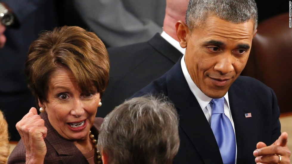 President Barack Obama, accompanied by House Minority Leader Nancy Pelosi of California, greets lawmakers and guests following his State of the Union address at the Capitol.