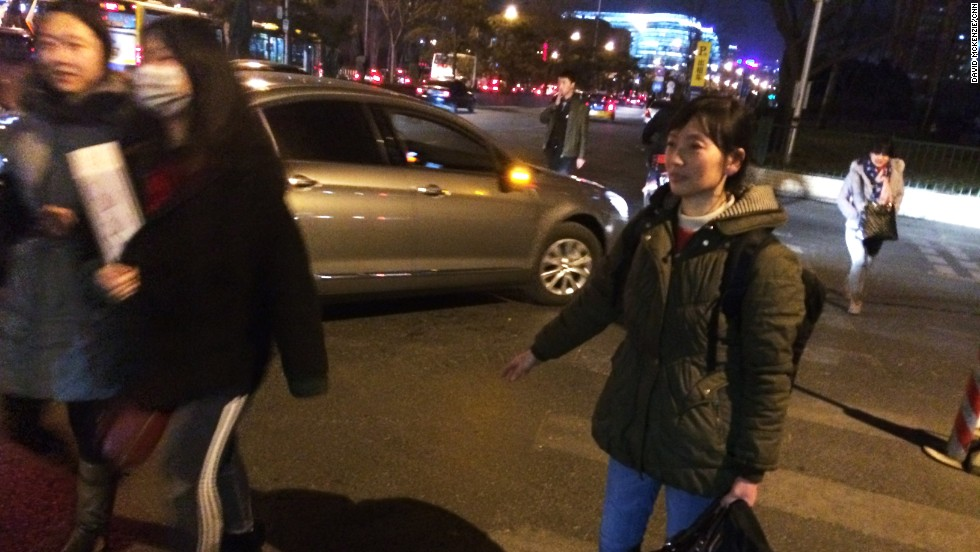 Zhou Xia, who works as a maid in Beijing, begins her 1,000 kilometer journey from the capital to her home in Anhui province for the Lunar New Year.