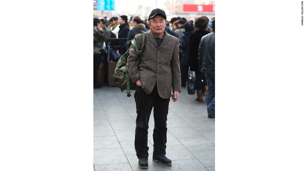 Meng Fanjun, 63, has for six years sold a local food specialty in a small town to the south of Beijing, Hebei province, called Baigou. He is passing through the capital to transfer to another train to go home to Haicheng, Liaoning province.