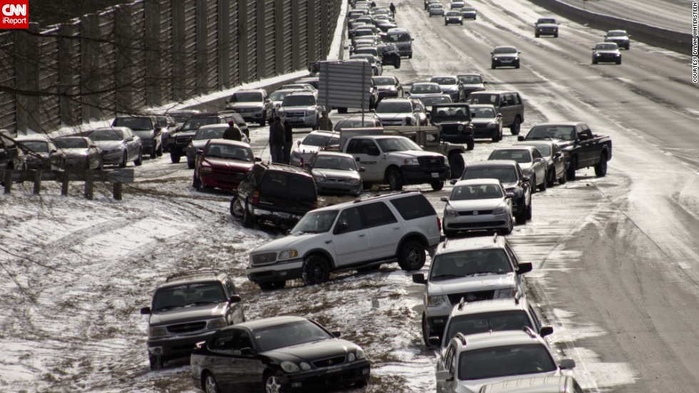 "As of Wednesday afternoon, hundreds of cars were still stranded on Atlanta's interstates, as seen in this photo taken on a GA 400 exit by iReporter <a href=""http://ireport.cnn.com/docs/DOC-1079567"">Dylan Wintersteen</a>. ""It's bizarre to see all the cars people abandoned and just left last night,"" he said."