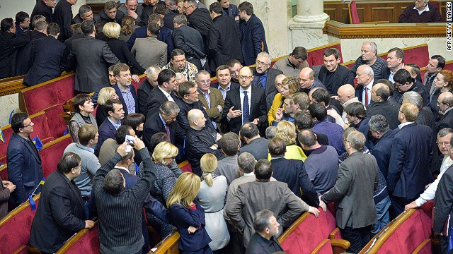 Opposition MPs debate at the Ukrainian parliament in Kiev on January 29, 2014 before the vote of a law that would grant an amnesty to protesters arrested during the country's crisis. The majority Regions Party backed the law with 232 deputies voting for and 11 against, after a rare closed-door meeting with President Viktor Yanukovych. However, the opposition did not vote, as they were unhappy that the law requires that protestors vacate buildings they have occupied in Kiev before it takes effect. A total of 173 MPs present in the parliament did not vote. AFP PHOTO / SERGEI SUPINSKYSERGEI SUPINSKY/AFP/Getty Images