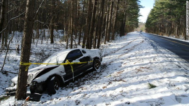 Caution tape is wrapped around a car that crashed into a tree after the driver lost contol in Snellville, Georgia, on January 29.