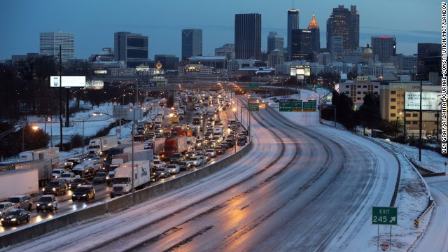 Atlanta's road and weather conditions (shown here on January 29) have delayed the airport's return to business as usual.