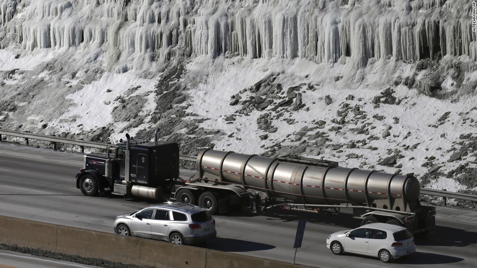 Traffic moves past an ice-covered hill on Interstate 75 in Covington, Kentucky, on January 29.