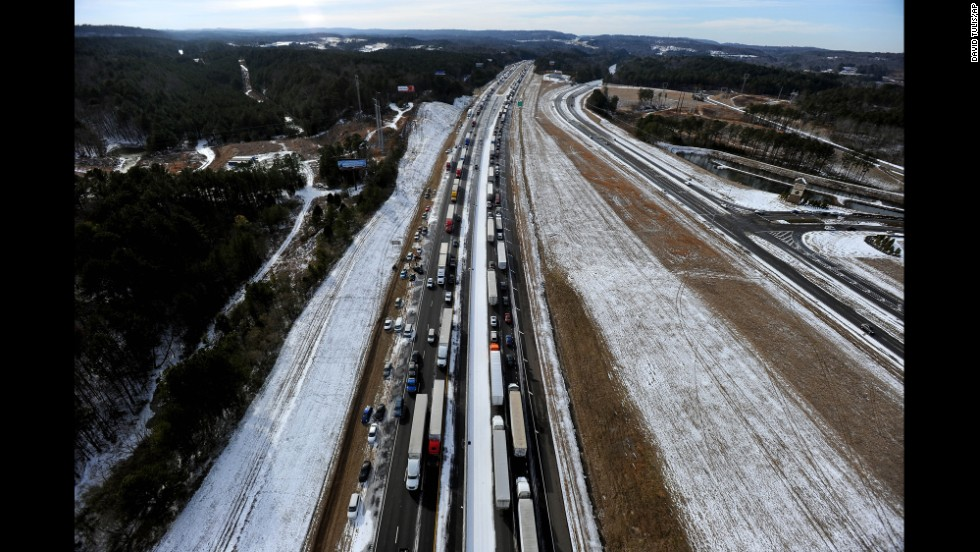Vehicles remain stranded along Interstate 20 in Leeds, Alabama, on Wednesday, January 29.
