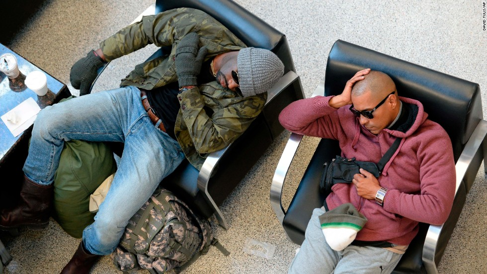 Travelers wait out flight delays at Hartsfield-Jackson Atlanta International Airport on January 30.