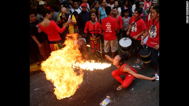 A fire eater performs in the Chinatown district of Manila, Philippines, on January 31.