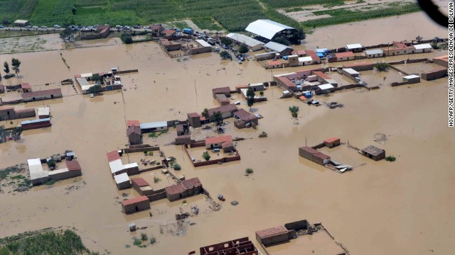 Handout picture released by the Bolivian Presidency press office showing an aerial view of the locality of Clisa, in Cochabamba, centre Bolivia, flooded by heavy rains affecting the country, on January 30, 2014. The Bolivian government has declared national emergency due to floodings which, up to now, have left more than 40 dead and more than 20,000 families affected.