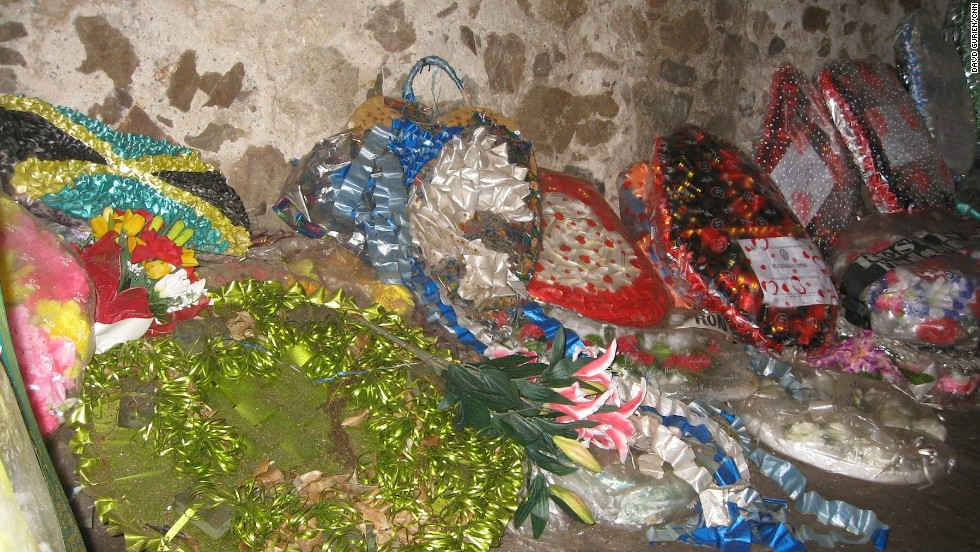 Gifts line the walls on the women's dungeon. The guide says they are left by descendents of slaves who have come back to understand their ancestors' enslavement, and to honor their them.