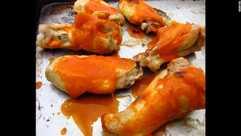 Most buffalo chicken wings are deep-fried and loaded with fat and calories. This fitter option calls for boiling and baking the wings.
