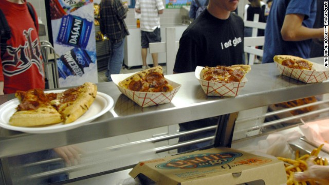 AUSTIN, TX - MARCH 11: Students line up to receive food during lunch in the cafeteria at Bowie High School March 11, 2004 in Austin, Texas. The Austin School District is working to make their cafeteria offerings more healthy, but the most popular foods are still fried chicken strips, pizza, and french fries. Concern about increased levels of childhood obesity in the United States has made the food served in public schools cafeterias a much greater concern. (Photo by Jana Birchum/Getty Images)