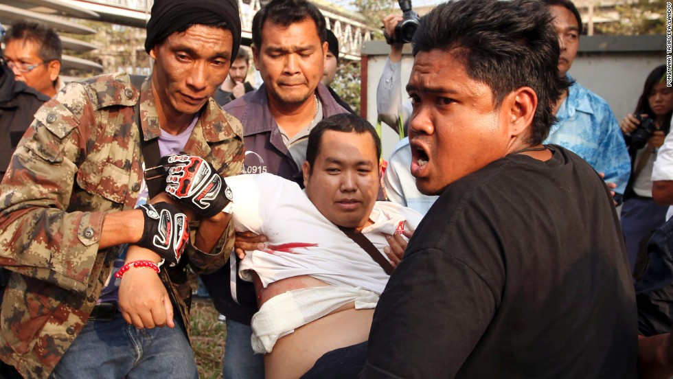 An injured government supporter is carried to a hospital during clashes with anti-government protesters in Bangkok on Saturday, February 1. Gunshots were fired during a confrontation, injuring at least six people.