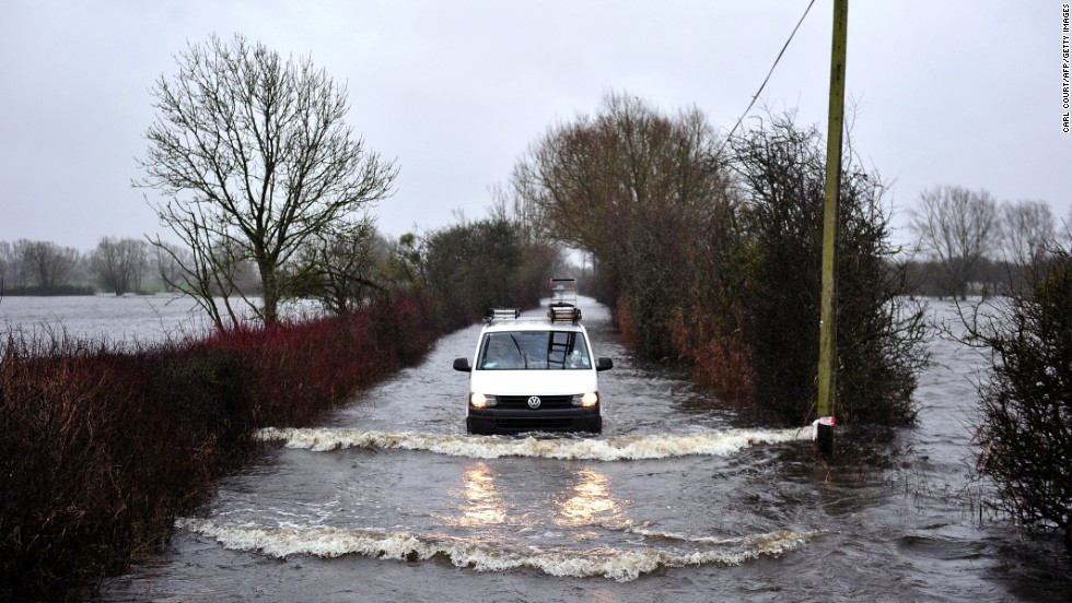 A van drives along a flooded road in Somerset, England, on January 31.