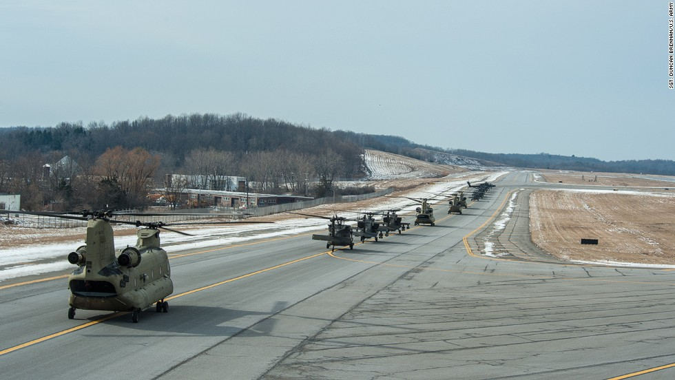 Not far from the stadium on Friday, pilots lined up their Apache and twin-rotor CH-47G Chinooks on a runway at Stewart International Airport in New Windsor, New York.