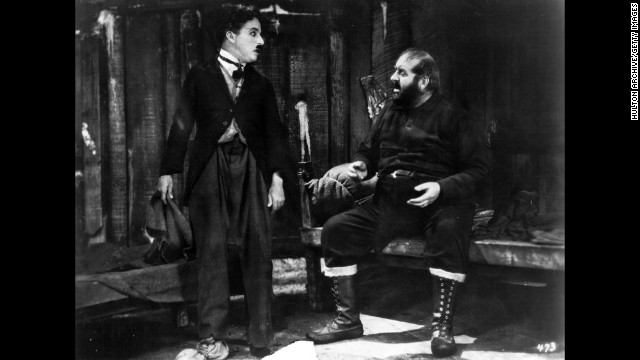 """In 1925's """"The Gold Rush"""" Chaplin's character ventures to Alaska on a quest for gold. Mack Swain also  appared in the film wrtiten, produced and directed by Chaplin."""