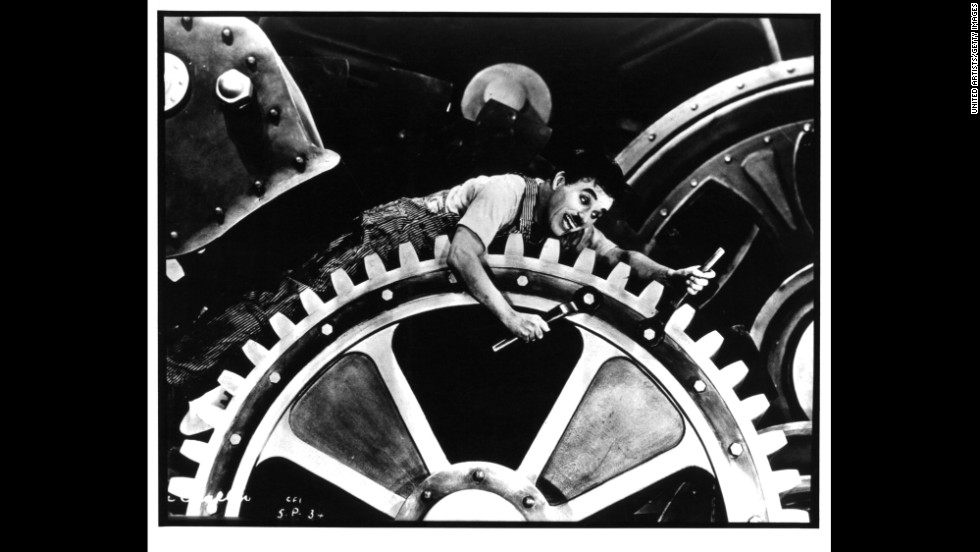 "In a 1936 silent film, made well after ""talkies"" revolutionized the movie industry, Chaplin takes on the challenges of the mechanical world in ""Modern Times."""