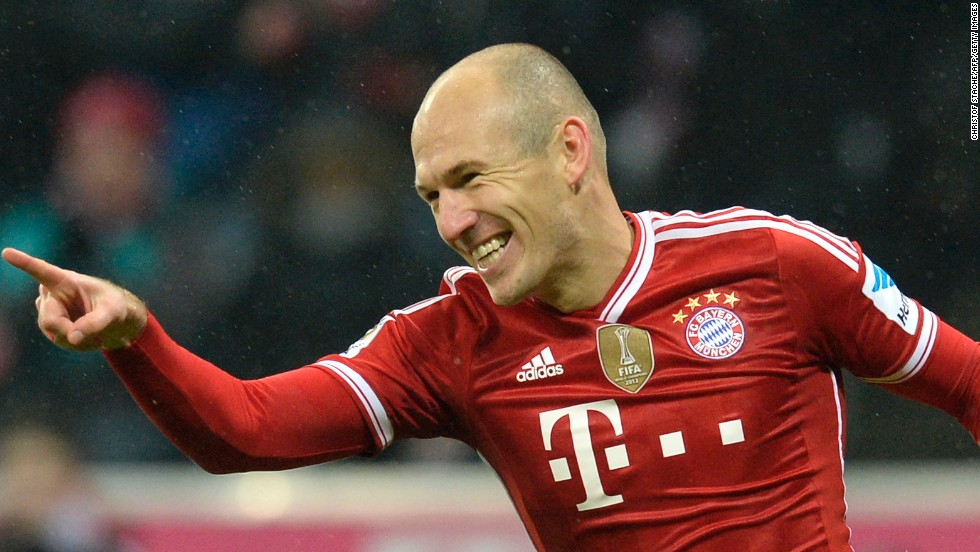 Arjen Robben celebrates after scoring Bayern Munich's third in the 5-0 rout of Eintracht Frankfurt at the Allianz Arena.