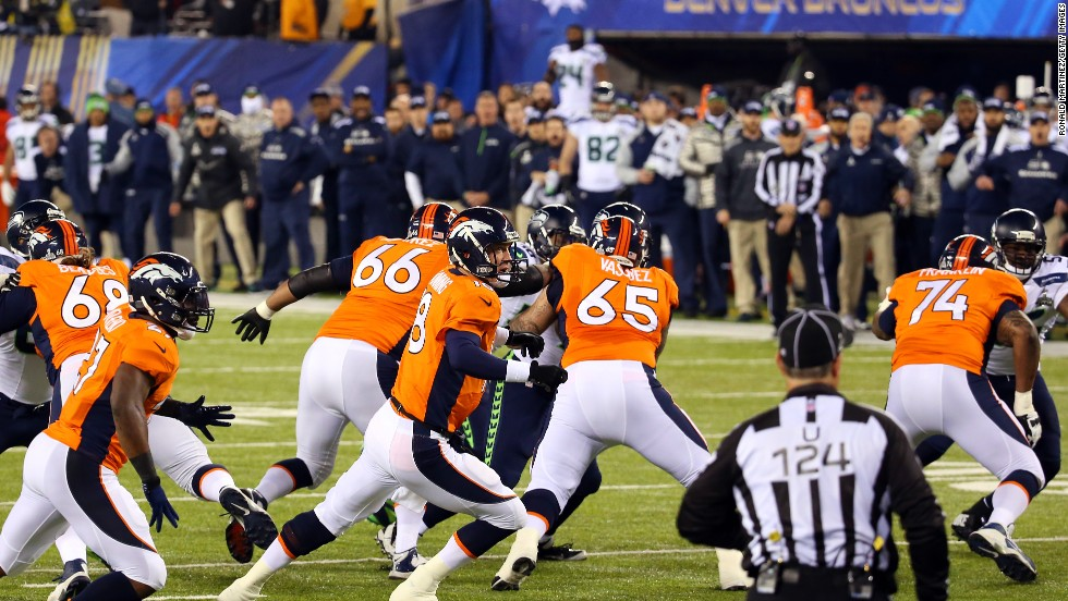 Denver makes a disastrous start as the ball sails over Peyton Manning from a snap which leads to a safety and points on the board for Seattle.