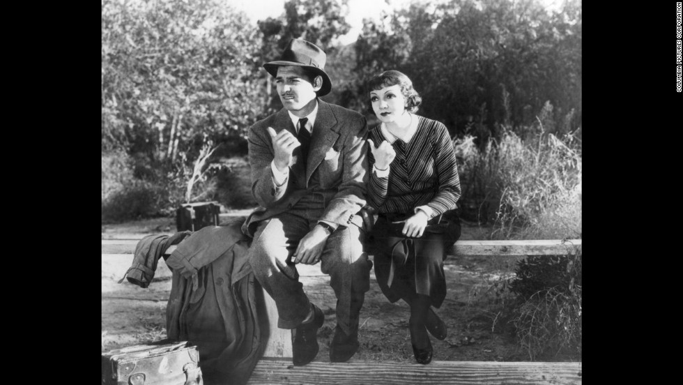 "Clark Gable and Claudette Colbert star in ""It Happened One Night,"" which in 1935 wins all five major Academy Awards: best picture, best director, best actor, best actress and best screenplay."