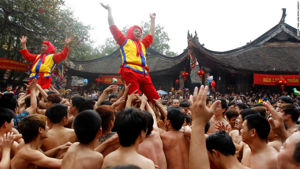 People from Dong Ky, Vietnam, perform a ritual during the village's traditional firecracker festival on February 3.