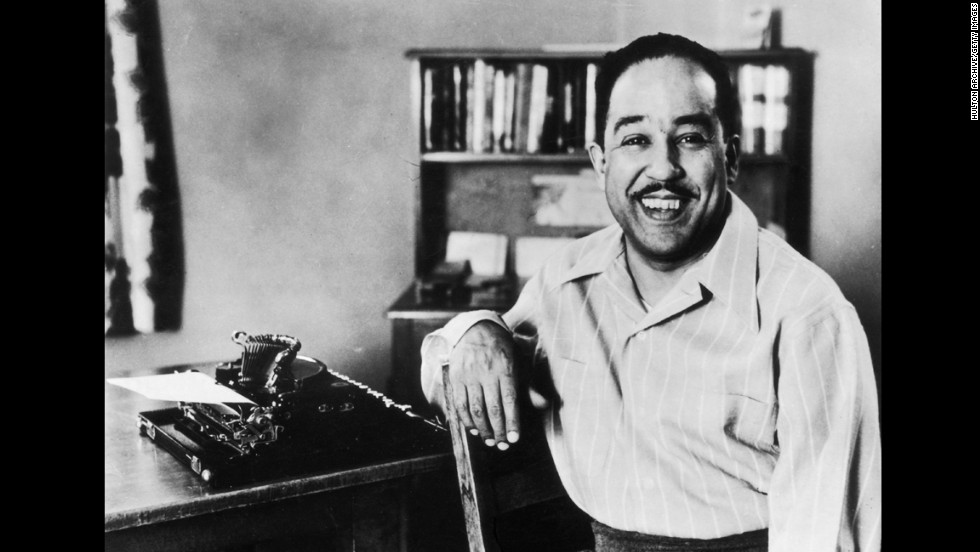 "Langston Hughes, known for the poem ""A Dream Deferred,"" sits with his typewriter circa 1945."