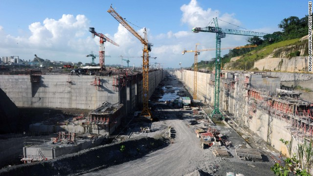 "The Panama Canal locks in Colon, 110 km northwest of Panama City, are seen under construction on January 17, 2014. The Grupo Unidos por el Canal (GUPC) consortium led by Spanish builder Sacyr --which includes Italian, Belgian and Panamanian companies-- has threatened to suspend the expansion work by January 20 unless Panama pays for $1.6 billion in ""unforeseen"" costs. Already facing delays, the project aims to make the 80-kilometer (50-mile) waterway, which handles five percent of global maritime trade, big enough to handle new cargo ships that can carry 12,000 containers."