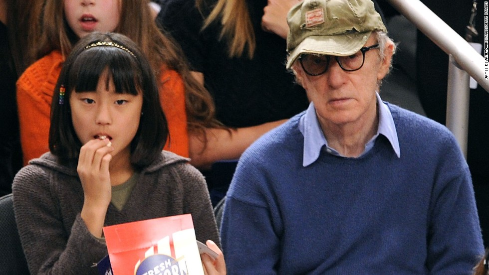 Woody Allen and adopted daughter Bechet Dumaine Allen attend a basketball game in 2009 at Madison Square Garden in New York. Her mother is Allen's current wife, Soon-Yi Previn.