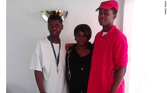Dinyal New with her two sons, Lee, pictured on the left, and Lamar.