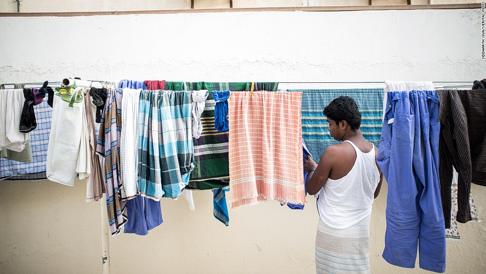 Men in Dubai's labor camps often live eight to a room, and have communal kitchen, bathroom and laundry facilities.