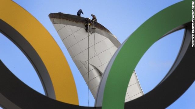 Workers check the Olympic cauldron at the Olympic Park's medals plaza in the seaside cluster prior to the start of the 2014 Sochi Winter Olympics on February 2, 2014 in Sochi.