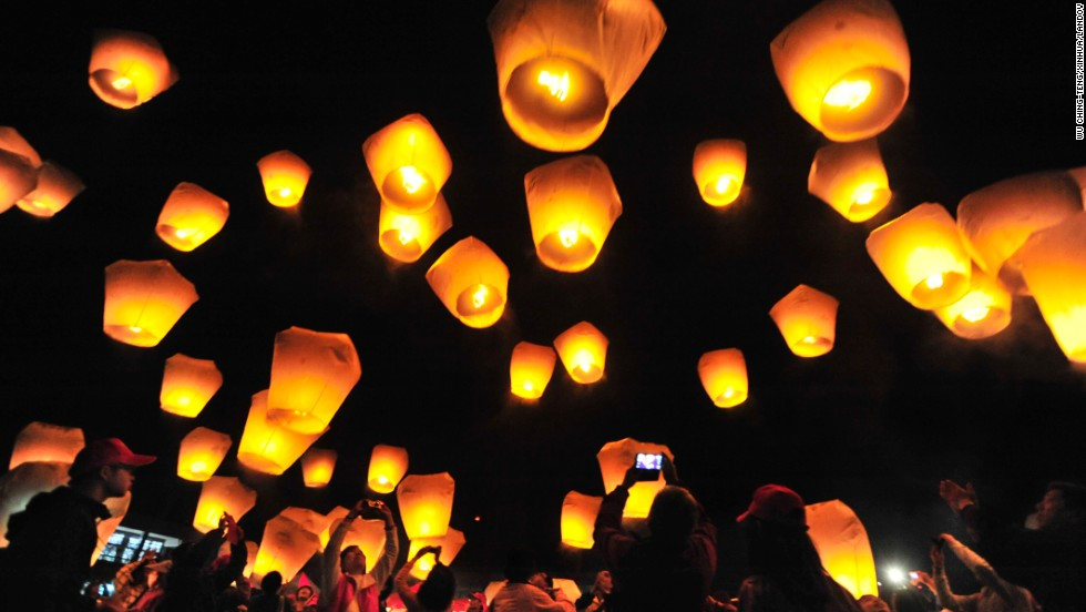 People release sky lanterns to celebrating the Lunar New Year in New Taipei City, Taiwan, on February 3.