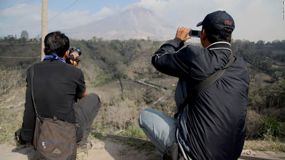 The volcano draws in local media and photographers all hoping to get the best shot or the chance at being there at the right time for the big one.