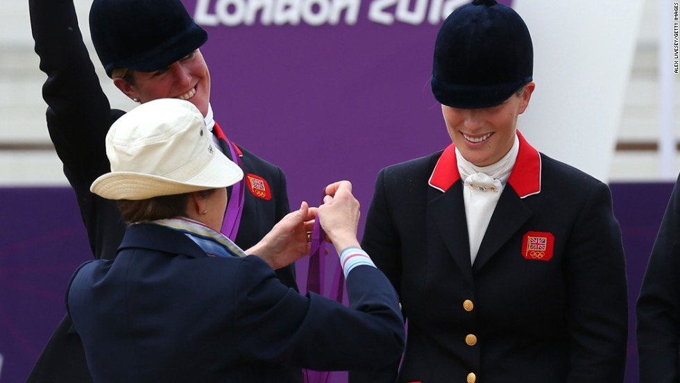 British Olympian Zara Phillips is presented with a silver medal by her mother, Princess Anne, after an equestrian event in the 2012 Olympics.
