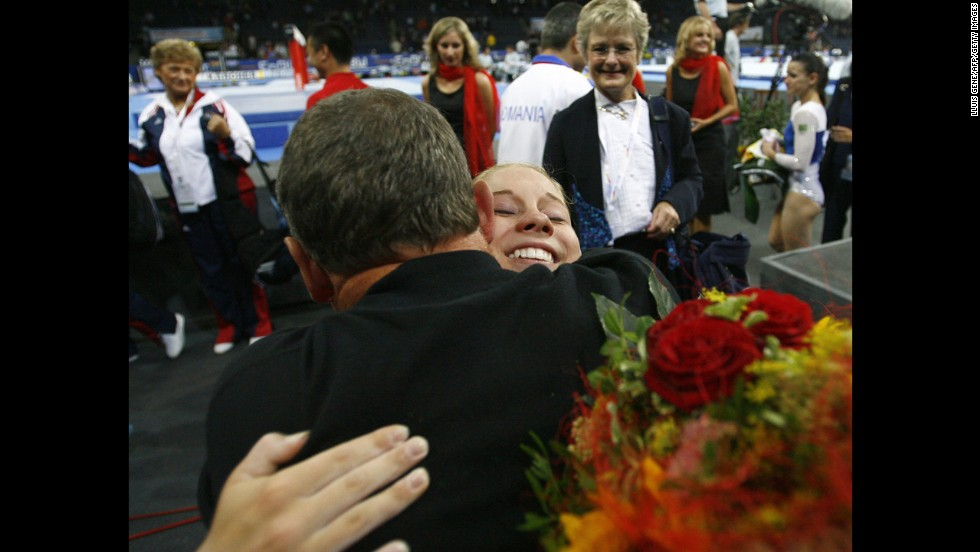 Gymnast Shawn Johnson celebrates with her father, Doug, after the United States won the women's team final at the World Artistic Gymnastics Championships in Germany in 2007.