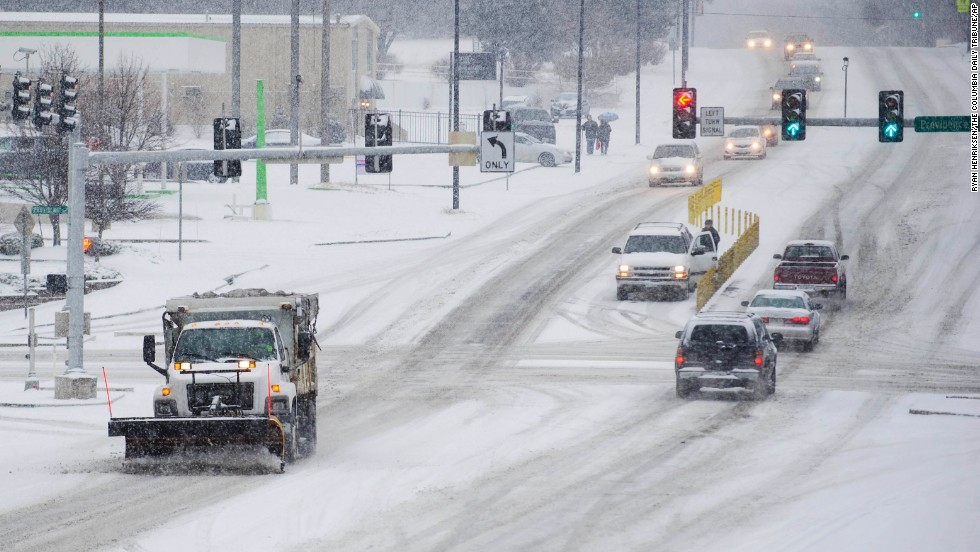 A salt truck clears a road in Columbia, Missouri, on February 4.