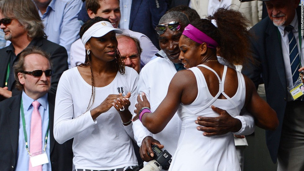 U.S. tennis player Serena Williams, right, climbs up to embrace her father, Richard, and her sister Venus after winning Wimbledon in 2012. Williams won Olympic gold later that summer.