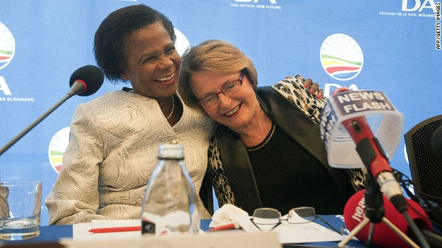 Helen Zille(R), leader of the Democratic Alliance(DA), is hugges by Mamphela Ramphele during a press conference where she was announced as the DA Presidential candidate for the upcoming 2014 South African elections, on January 28, 2014, in Cape Town. South Africa's centrist opposition parties joined forces Tuesday to challenge the ruling ANC at upcoming elections, with black consciousness stalwart Mamphela Ramphele tapped as their presidential candidate. The opposition Democratic Alliance (DA) announced it would field Ramphele -- the partner of slain South African hero Steve Biko -- to face beleaguered incumbent president Jacob Zuma. AFP PHOTO / RODGER BOSCHRODGER BOSCH/AFP/Getty Images