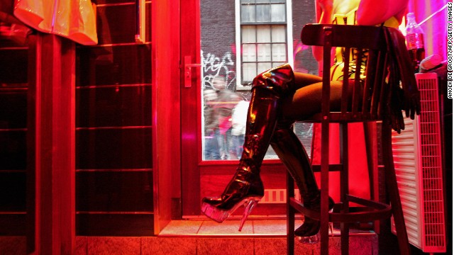 A German prostitute, called Eve, waits for clients behind her window in the red light district of Amsterdam.