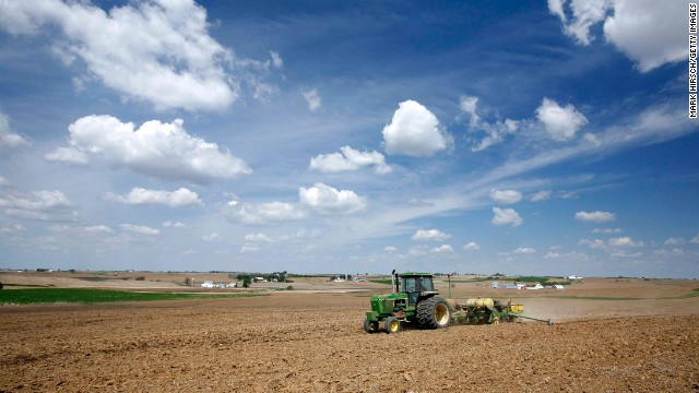 "LUXEMBURG, IA - MAY 9:  Iowa farmer Ernie ""George"" Goebel pulls a corn planter behind his John Deere tractor while planting corn in a field on the farm he was raised on May 9, 2007 near Luxemburg, Iowa. With the increase in demand for alternative energy some farmers have elected to switch to growing corn in order to produce the profitable ethanol fuel. In the nation approximately 90 million acres of corn are expected to be planted this season.  (Photo by Mark Hirsch/Getty Images) *** Local Caption *** Ernie Goebel"