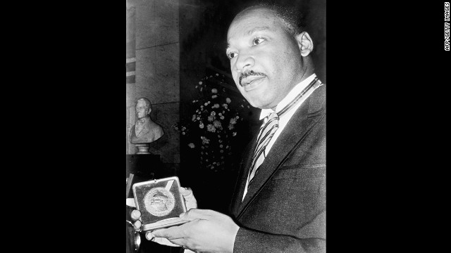 Caption:	 US clergyman and leader of the Movement against Racial Segregation Martin Luther King, displays 10 December 1964 in Oslo his Nobel Peace Prize medal. The only black man whose birthday is a national holiday, Martin Luther King was the leader of the moral fight against racism in America wen he was fatally shot by James Earl Ray 04 April 1968 at the age of 39. (Photo credit should read -/AFP/Getty Images)