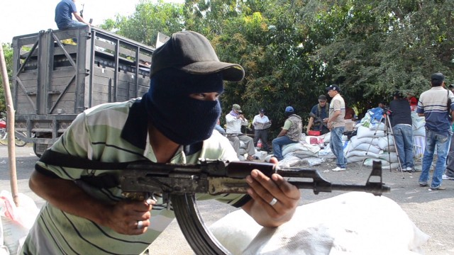 Mexican vigilantes take on drug cartel
