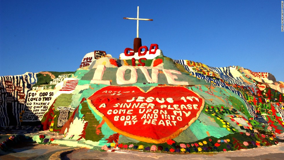 "Salvation Mountain creator Leonard Knight wanted to express that ""God is Love."" This 50-foot tall adobe mountain in the California desert was his canvas."
