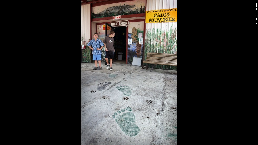 Painted footprints mark the entrance to the Skunk Ape Research Headquarters shown in Ochopee, Florida. Founder Dave Shealy has devoted decades to proving the existence of the Florida skunk ape.