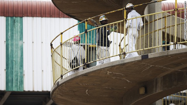 Workers arrive at the Doornkop gold mine west of Johannesburg on February 5, 2014.