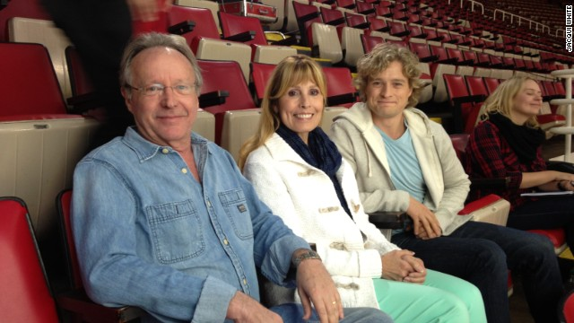 Ice dancer Charlie White sits with his parents, Charlie and Jacqui White.