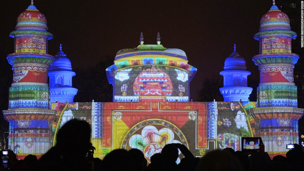 Animation is projected onto a large snow replica of India's Tomb of Itmad-ud-Daulah. The real Mughal mausoleum is in Agra in the Indian state of Uttar Pradesh.