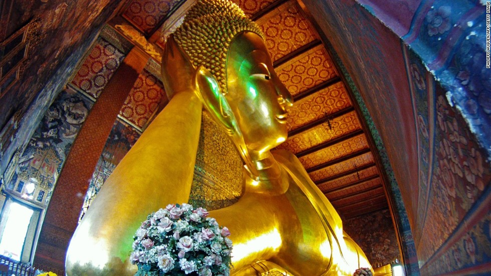 Bangkok's Wat Pho temple complex is home to Thailand's biggest reclining Buddha. The statue is 15 meters high and 43 meters long.