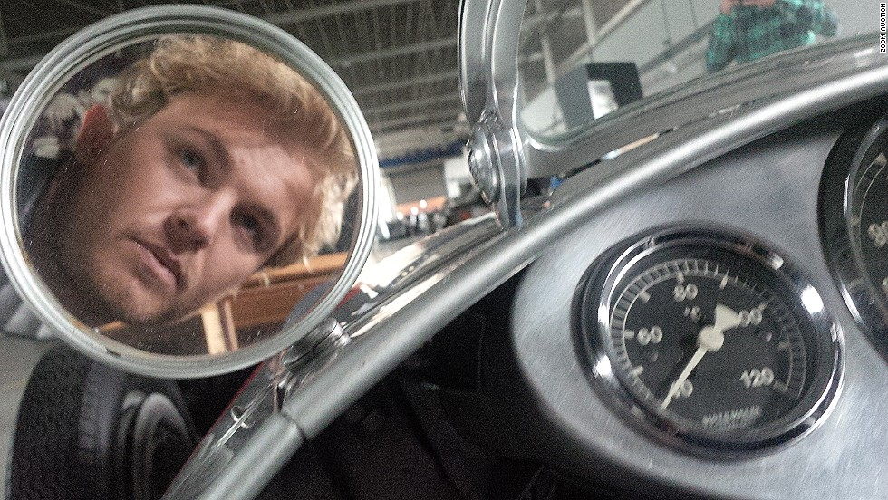 "How about this retro self portrait from Mercedes driver Nico Rosberg for your living room? The German race winner explains: ""I'm at the wheel of the 1938 W 154 in Stuttgart."""
