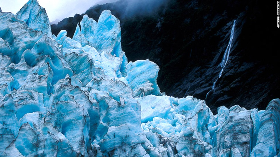 The 12-kilometer-long glacier descends from the Southern Alps through temperate rainforest to near sea level.